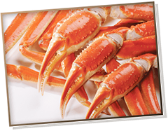 Picture of cooked snow crab legs with three claws over them